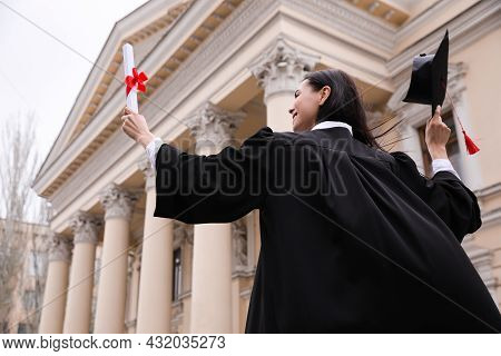 Student With Diploma After Graduation Ceremony Outdoors, Low Angle View