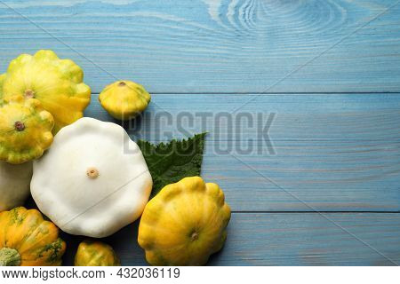 Fresh Ripe Pattypan Squashes With Leaf On Light Blue Wooden Table, Flat Lay. Space For Text