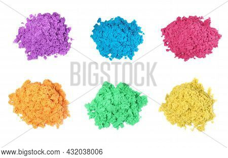 Set With Piles Of Colorful Kinetic Sand On White Background, Top View