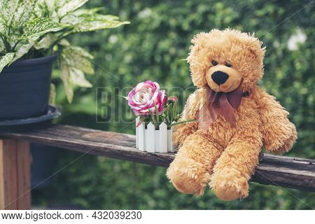 Smiling Teddy Bear Best Friends Toy For Kids. Adorable Fluffy Brown Teddy Bear Happy In Green Park.