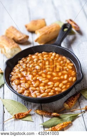 Baked beans, classic american staple food served in a skillet
