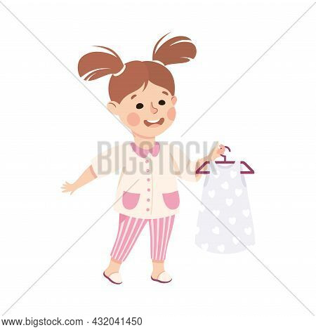 Little Girl With Ponytails With Pretty Dress On Hanger Engaged In Daily Activity And Everyday Routin