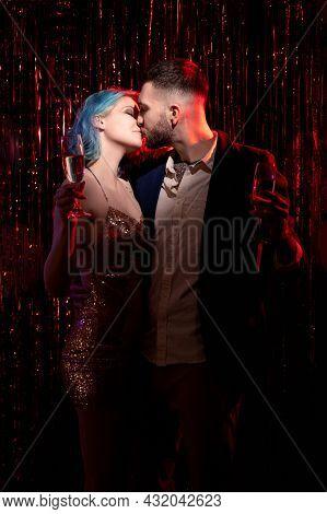Enjoying Love. Beloved Couple. Romantic Date. Anniversary Celebration. Festive Man And Woman Kissing