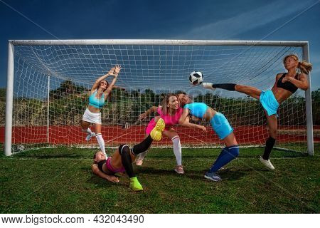 Female Soccer players on a soccer stadium. Girls Team emotionally playing football