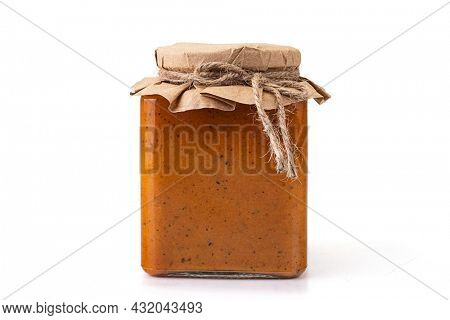 Preserved squash caviar in glass jar. Isolated on white background