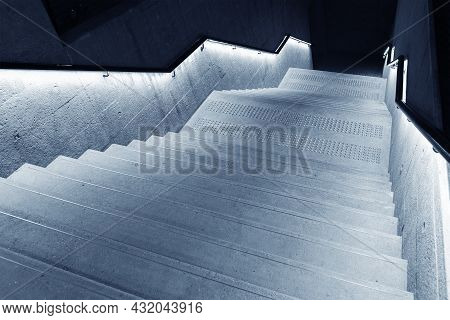 Interior View Of Empty Stairway With Illuminated Bannister In Modern Architecture