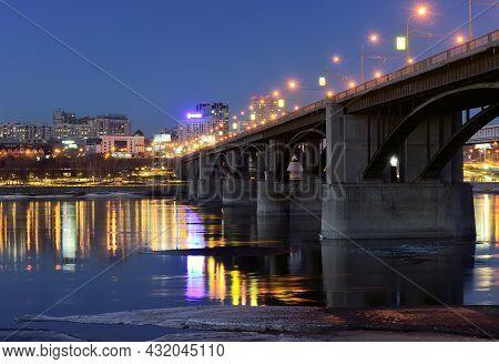 Oktyabrsky Automobile Bridge Over The Ob River. Powerful Pillars, Night Lights, Bright Reflections I