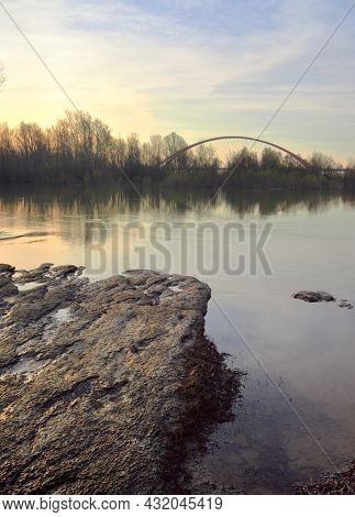The Bank Of The Ob River In Novosibirsk In Spring, An Arched Bridge And Trees On The Horizon, Golden