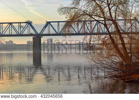 Early Morning On The Great Siberian River, Golden Dawn, A City On The Bank In The Distance, Railway