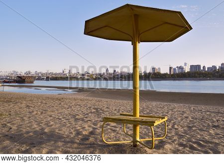 Umbrella Canopy On The Autumn Sandy Beach On The Banks Of The Ob River In The Capital Of Siberia. A