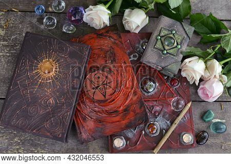 Beautiful Decorated Book With Spells Or Fairy Tales, Crystals And Roses On Planks.  Esoteric, Gothic
