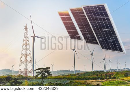 Solar Panels With Wind Turbines Against Mountanis Landscape Power And Energy.