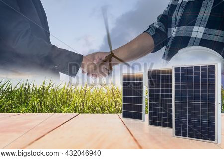 Power And Energy Concept Of Solar Panels With Businessman And Engineer Handshake Agreement.