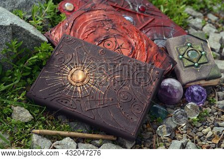 Witch Book Of Magic Spells With Crystals In The Garden.  Esoteric, Gothic And Occult Background, Hal