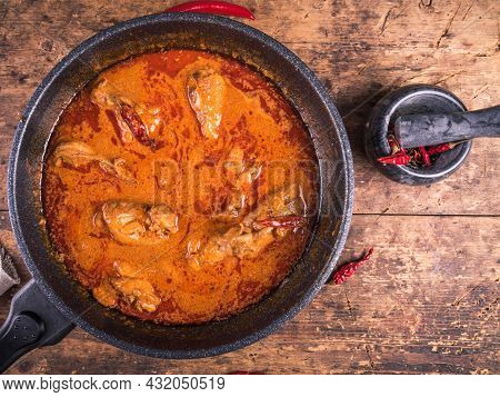 Cooking Spicy Chicken Stew With Paprika And Sour Cream Sauce In A Frying Pan - Chicken Paprikash, To