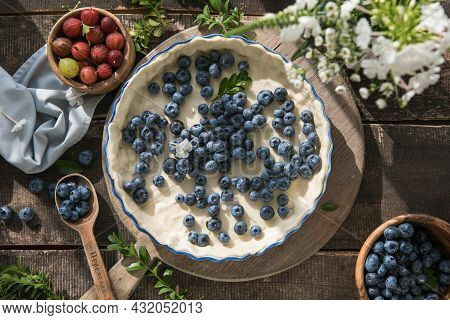 Homemade Pastry Blueberry  Pie Pies Bakery Products On Dark Wooden Kitchen Table . Traditional Desse