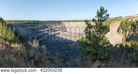 Operating Quarry For The Extraction Of Gray Granite Located Among The Forest, View With Young Pine O