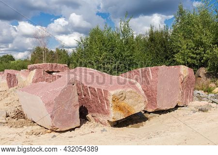Large Blocks Of Red Granite With Flat After Stone Cutting Tool And Torn Edges, With Marks Of Implodi