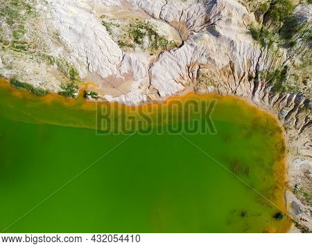 Part Of Colored Lake And Old Waste Rock Dumps On The Site Of The Abandoned Ilmenite Quarry, Vertical