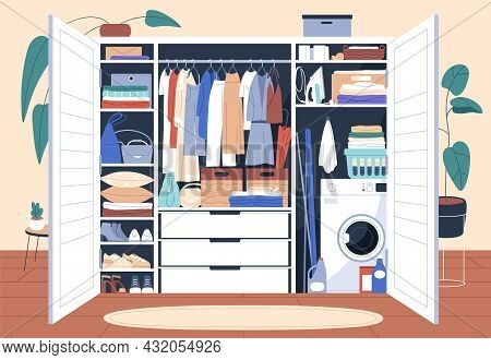 Decluttered Wardrobe With Organized Storage Of Clothes, Hanging On Racks And Folded On Shelves. Insi
