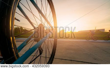 Blur Photo Sports Man Ride Bicycles With Speed Motion On The Road In The Evening With Sunset Sky. Su