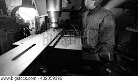 Milling Machine Working Near Worker With A Protective Mask. Tool For Cut Metal Workpiece. Vertical M