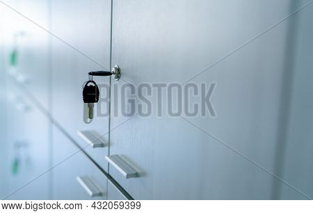 Locker With Key In Office Room. Filing Cabinet Lock With Key For Safety And Security System In Publi