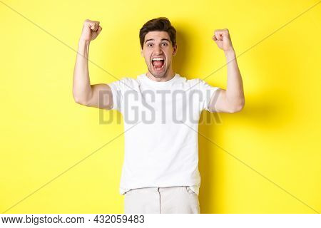 Image Of Excited Man Winning, Raising Hands Up And Celebrating, Triumphing And Rooting For Team, Sta
