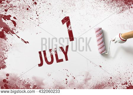 July 1st . Day 1 Of Month, Calendar Date. The Hand Holds A Roller With Red Paint And Writes A Calend