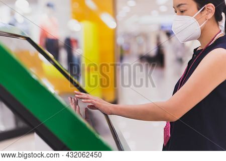 Woman In Protective Mask Hand Uses Digital Touch Screen To Get Information
