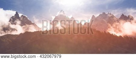 Fantastic Evening Snow Mountains Banner Landscape Background. Colorful Pink And Blue Clouds Overcast