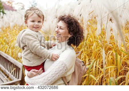 Happy Mother And Her Little Child. Smiling Child Playing With Mother In The Park. Mother And Son Emb