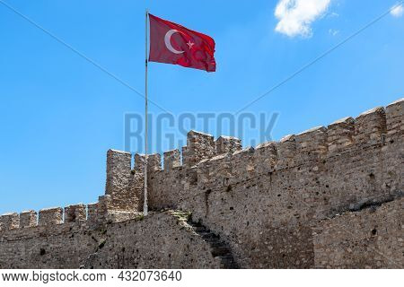 Selcuk, Turkey - June 4, 2021: This Is The Flag Of Turkey Over The Ancient Byzantine Castle On The A