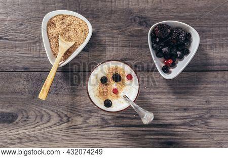 Fresh Yogurt With Wheat Bran And Banana And Berries