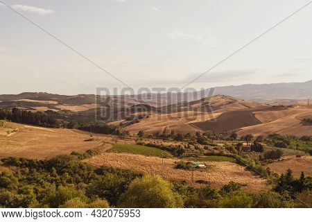 Panoramic View Of The Tuscan Countryside With The Characteristic Colors Of Its Hills.