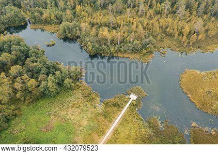 Autumn Lake Surrounded By Forest Izvara Park, Volosovsky District, Leningrad Region Russia. Aerial V