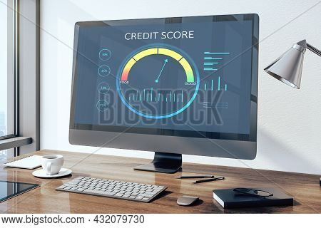 Close Up Of Wooden Desktop With Computer Monitor And Abstract Credit Score Scale On Screen. Finance