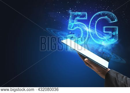 Businessman Hand Holding Smartphone With Creative Glowing 5g Hologram On Blue Background. Internet S