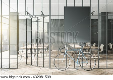 Contemporary Glass Partition And Bike In Stylish Coworking Office Interior With Empty Black Mock Up