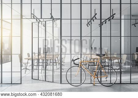 Modern Glass Partition And Bike In Stylish Coworking Office Interior With City View And Daylight. 3d