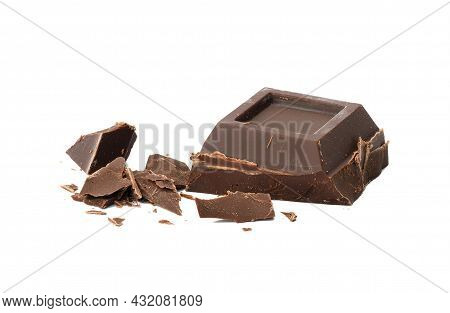 Broken Black Chocolate With Pieces Isolated On White Background. Dessert Bar Of Chocolate, Close Up