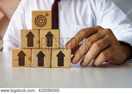 Business Success Concept. Cubes With Arrows And Target On The Top. Reach Goals.