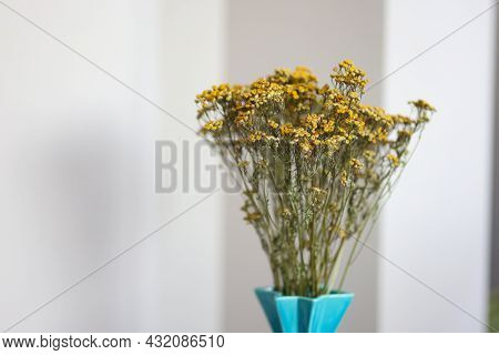 Yellow Dried Statice Flowers In A Vase