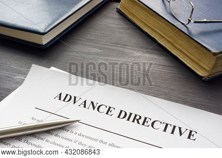 Medical Advance Directive Form And Book With Glasses.