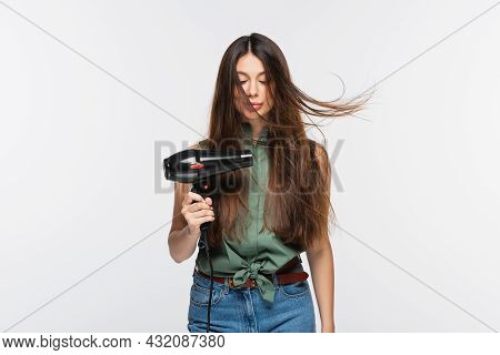 Young Woman With Shiny Hair Using Hair Dryer Isolated On Grey