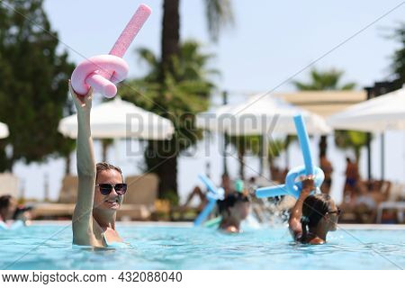 Young Women During Water Aerobics Classes In Hotel Pool Closeup