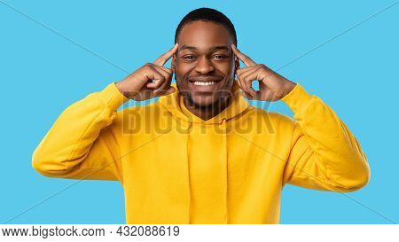 Cheerful African Man Pointing At Forehead Over Blue Background, Panorama