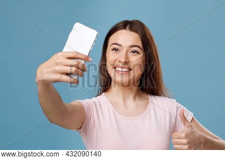 Smiling Fair-haired Young Woman Taking Selfie On Smartphone, Closeup