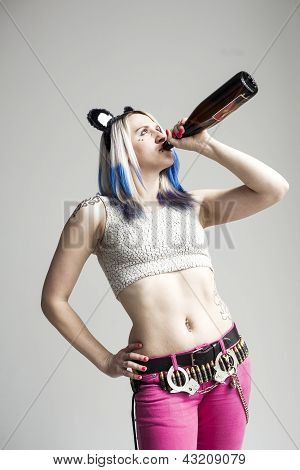 Beautiful Young Woman With Blue Hair Drinking A Bottle Of Wine