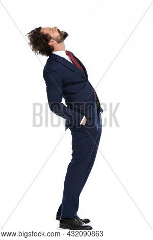 side view of a businessman looking up and feeling irritated against white background